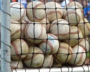 baseballs in a basket