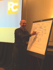 David Lee writing ideas from brainstorm at training