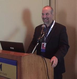David Lee at podium at APHA conference