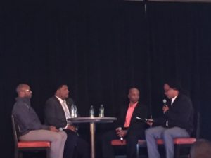 Picture of 4 men sitting around a table on the panel