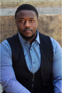 African AMerican man short dark hair with blue shirt and vest