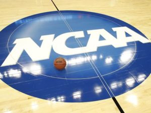 Bakset ball on floow wirth bllor c=icle with NCAA in white text