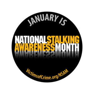 Round black with white writing saying January is National Stalking Awareness Month VIctimsOfCrime.org/NSAM