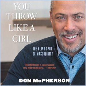 Cover of book You Throw LIke a Girl: The Blind Side of Masculnity with pciture of authro Don MsPherson, African AMerican man with beared wearing blue shirt and darker blue sweater
