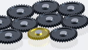 steel-gears-in-connection-with-gold-one-concept-for-teamwork-and-business