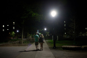 two peopel wlaking at night on college campus setting