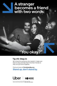 """A group of people with drinks in their hands pose for a selfie. Text says """"A stranger becomes a friend with two words: 'You Okay?'"""""""